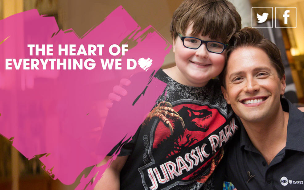 The heart of everything we do. Brett Chukerman posing with a child wearing a Jurassic Park t-shirt
