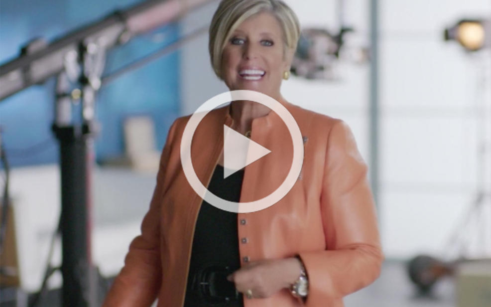Suze Orman in a peach jacket