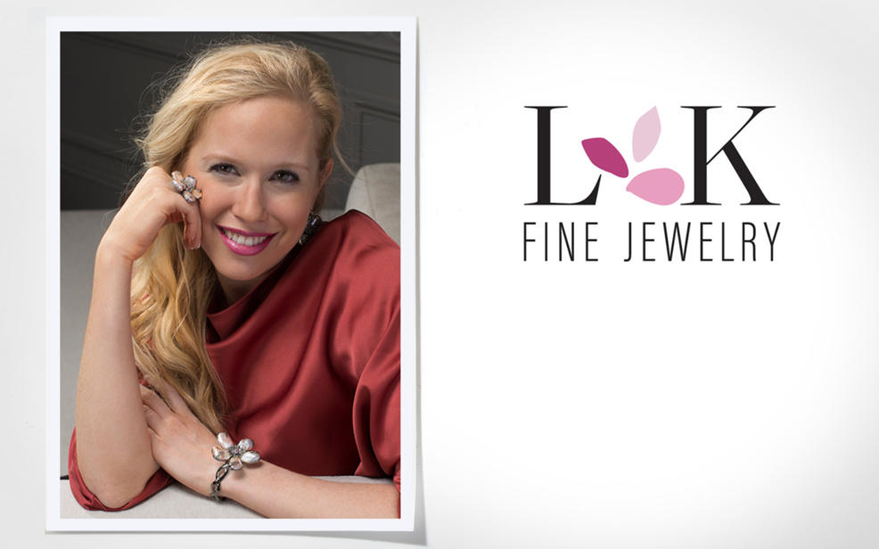 L K Fine Jewelry. A portrait of Lisa Klein wearing a ring and bracelet decorate with floral designs.