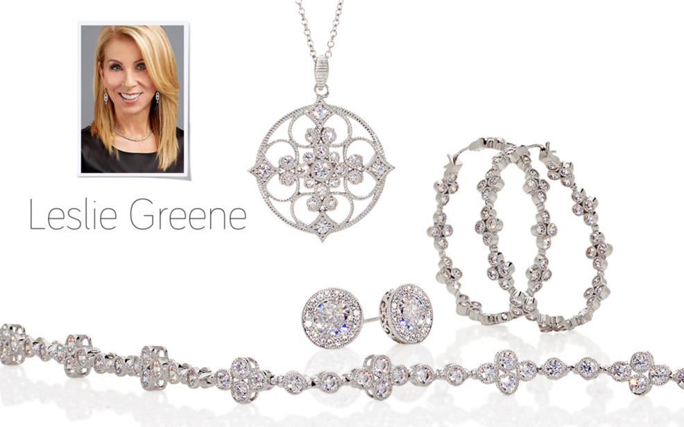 Leslie Greene. Several pieces of silver jewelry decorated with clear gemstones.