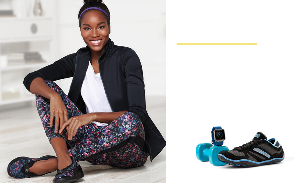 A woman sits wearing workout clothing. There is a running shoe, a dumbbell and a fitbit nearby.
