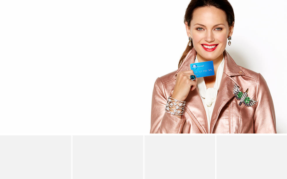 A woman smiling and holding her HSN Card