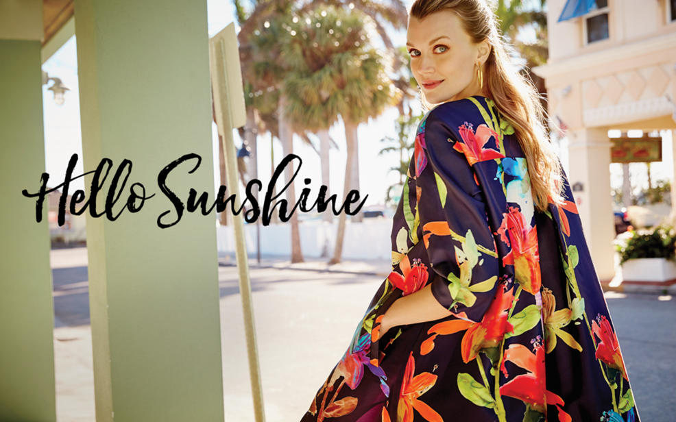 Hello Sunshine. Woman in colorful flower print coat