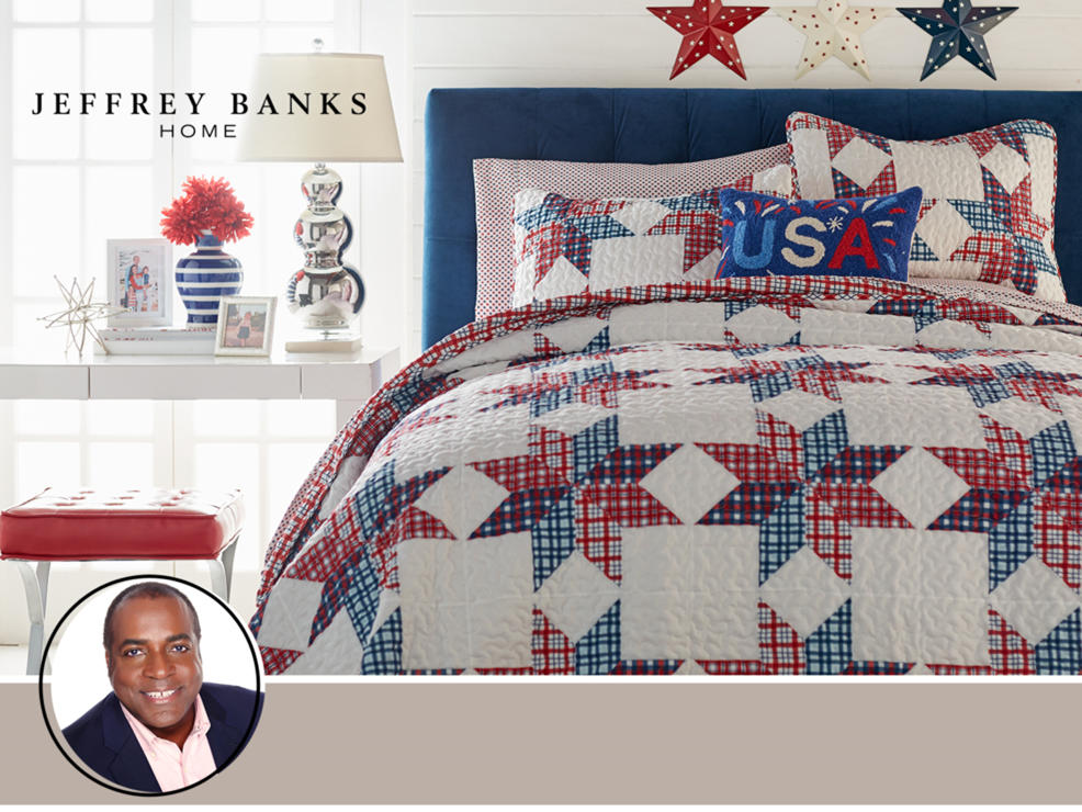 Jeffrey Banks Home. A bed decorated in red, white and blue with a USA pillow.