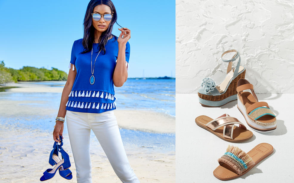 A woman on a beach holds blue sandals. Wedge sandals and flip-flops.