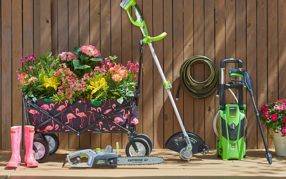 several potted flowers and lawn equipment