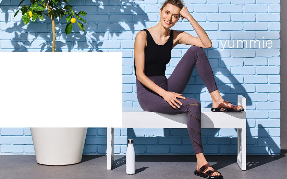 yummy. a woman sits on a bench in comfortable casual wear.