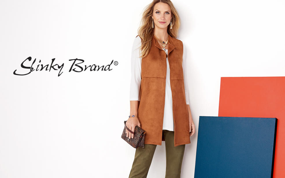 Slinky Brand. A woman in a brown vest, white top and green slacks.