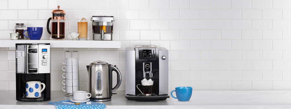 several coffee machines, cups and coffee.