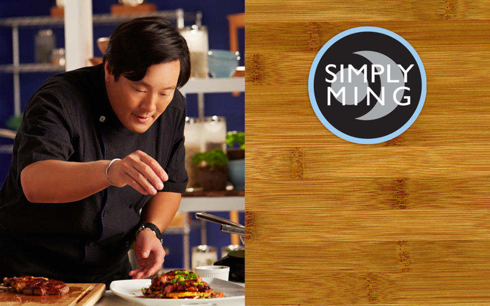 ming tsai. ming sprinkles spices on some food