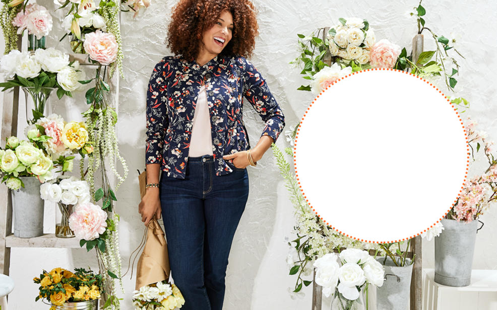 ca46f01cd6 a woman in a floral jacket and jeans surrounded by flowers