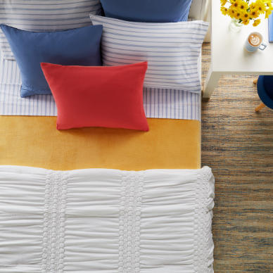Multicolored pillows on a bed
